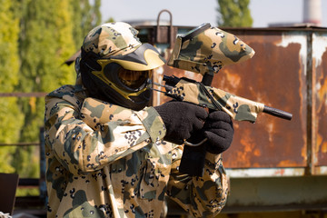 Paintball player in camouflage outdoors