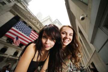 Two young women near New York Stock Exchange
