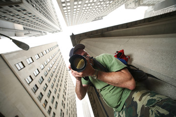 Klistermärke - Photographer in New York City. Wide angle view from below.