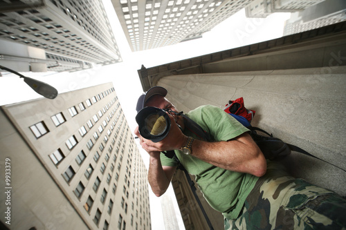 Fotobehang Photographer in New York City. Wide angle view from below.