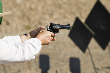 pistol shooting in a cowboy action shooting competition