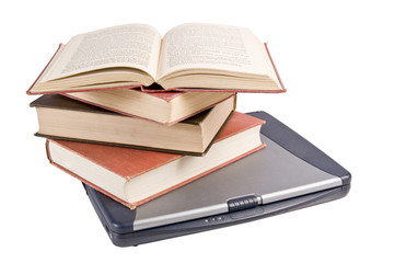 small stack of books on a laptop