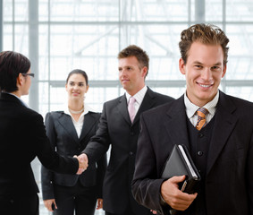 Team of business people, businessman in front,