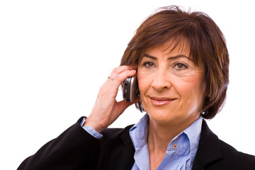 Senior businesswoman calling on mobile phone