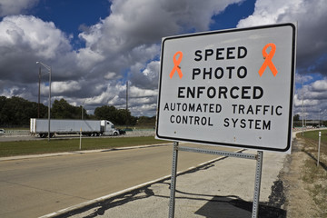 Speed photo enforced - sign on the expressway