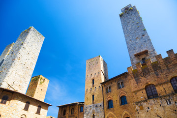 High ancient towers in Italian city. Wide angle view.