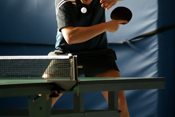 table tennis player serving