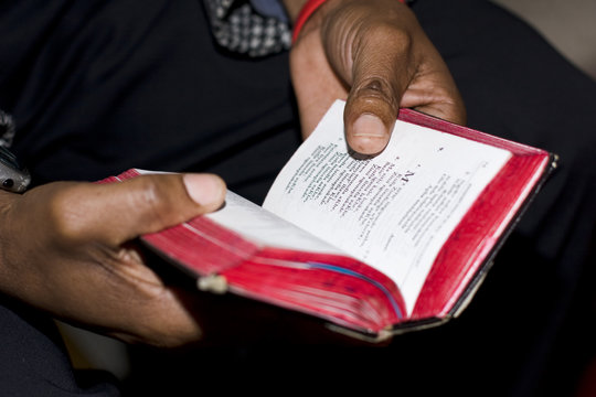 Prayer Service with book held by two hands
