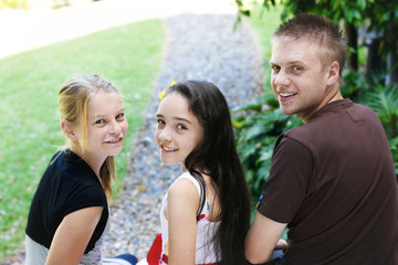 Three cute kids together outdoors