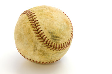 Old, skuffed baseball  on a white field with a clipping path
