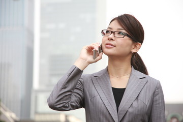 businesswoman talks with a mobile phone