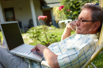 Healthy senior man is his elderly 70s sitting outdoor