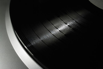 A shiny vinyl record plate