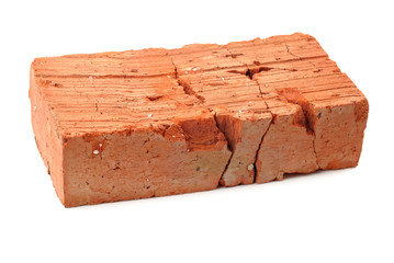 Cracked red brick isolated over white background