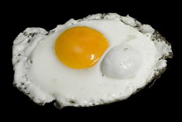 A shot of a fired egg isolated on black.