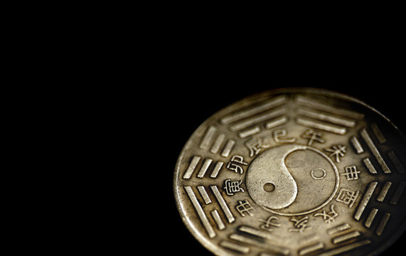 The Chinese silver coin with Bagua and Hexagrams