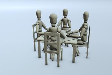 Vier Figuren sitzen am Tisch