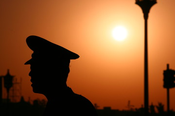 Chinese Police Silhouette with Sunset
