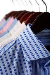 Close-up rack shirts isolated on white background