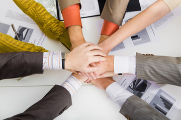 Close-up of pile of hands of business partners