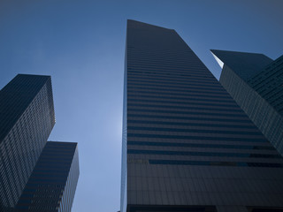High modern skyscrapers on a background of a blue sky.