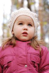portrait a little girl in white hat
