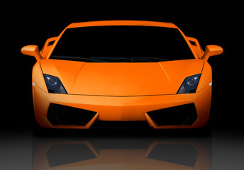 Bright orange modern supercar in studio. Front view.