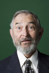 Portrait of a senior bearded man with a surprised look