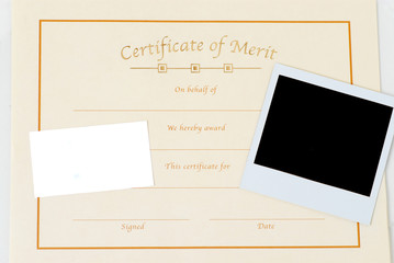 blank polaroid picture and certificate