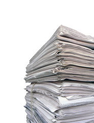 Newspaper stack on white background.