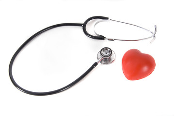 A conceptual stethoscope on heart isolated in white