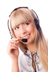 beautiful young blond woman wearing earphones with a microphone