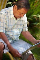 Healthy senior man is his elderly 70s sitting outdoor in garden