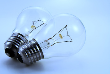 Two electric bulbs. Blue tinted image