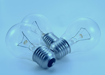 Tinted image of three electric bulb