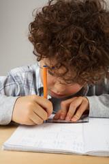 Young boy doin homework