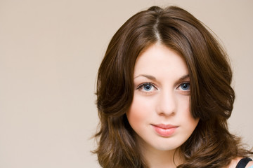 Close-up portrait of a beautiful girl with blue eyes, isolated