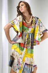female model posing in fashion dress..