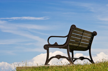 Wooden bench against a blue sky