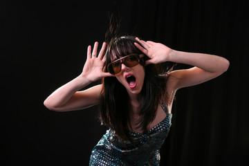 Beautiful woman having fun and posing with hands up. Studio shot