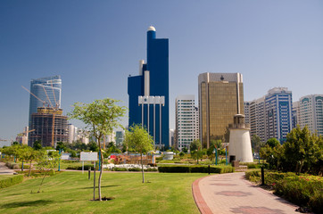 View of Abu Dhabi Skyline with gardens and small lighthouse