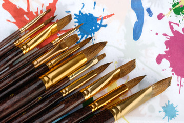 Paintbrush. Brushes for drawing. C blur a color background