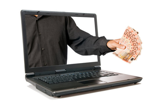Hand with money come out from a screen of a laptop