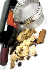 wine, dried fruits, spices and metal strainer