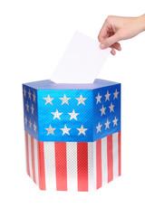 Hand casting vote into ballot box