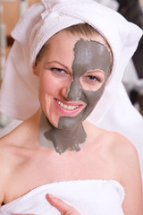 beautiful and happy woman having a face care spa therapy