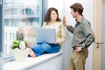 Male and female office workers talking and brainstorming
