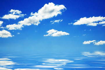 Background of deep blue sky and clouds above water