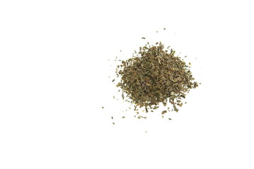 Small pile of dried basil herb on white