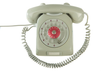 Dirty and scratched rotary telephone, isolated on white